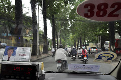 Taxi in the traffic (Roving I) Tags: trees streets traffic taxis vietnam scooters publictransport cabs hochiminhcity meters hcmc