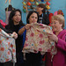 UN Women Executive Director Michelle Bachelet visits the textile production and trade center of Gamarra in Lima, Peru, on 16 October 2012 together with Peruvian First Lady Nadine Heredia