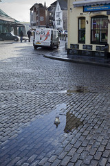 Reflected light (Peter Trott) Tags: light reflection puddle plymouth barbican devon cobbles