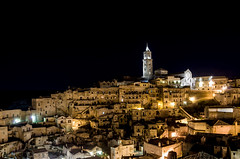 Matera by night. (Photos On The Road) Tags: old city light urban italy house building heritage tourism church horizontal architecture night buildings landscape outside outdoors lights town ancient europa europe italia cityscape view nocturnal cathedral outdoor hill nobody nopeople landmark panoramic basilicata belltower unesco chiesa campanile southern belfry historical urbano typical matera sassi oldtown pietra turismo borgo nocturne notte paesaggio collina fascinating citt notturno edifici cattedrale rupestre lucania tipico outdoorshots meridionale rupestrian orizzontale characteristic outdoorshot