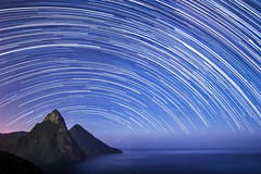 St Lucia & The Pitons - Startrails (Baggers 2013) Tags: blue sea mountains hot landscape rainforest sticky jungle tropical moonlight caribbean cosmic tropics stlucia humid startrails pitons lookingsouth soufriere saintlucia photostack petitpiton grospiton flickrchallengegroup flickrchallengewinner