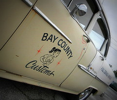 Bay County Customs (Dave* Seven One) Tags: sexy chevrolet belair 1955 girl sign shop sedan cool rat garage rusty bowtie scratches chevy cleavage custom mechanic wrench dents ratty 55chevy girlygirl 55belair