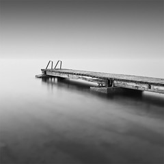 The Pier to the Infinite (DavidFrutos) Tags: longexposure sea bw costa seascape beach water monochrome sunrise square landscape monocromo coast pier mar agua playa paisaje bn alicante amanecer filter le lee embarcadero canondslr 1x1 torrevieja filtro largaexposición filtros neutraldensity canon1740mm gnd8 graduatedneutraldensity densidadneutra davidfrutos 5dmarkii niksilverefexpro singhraygallenrowellnd3ss