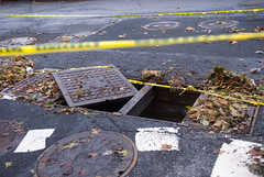 Manholes torn off by Hurricane Sandy on 102nd Street & FDR Drive (juliacreinhart) Tags: nyc newyorkcity newyork storm rain weather river drive flooding wind harlem manhattan sandy hurricane nypd cleanup east recovery fdr stormclouds severe severeweather hurricanesandy