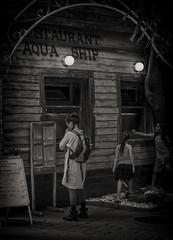 Aqua ship (hristo.savov) Tags: sofia street blackwhite woman restaurant wooden facade