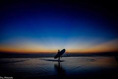 "The Surfer                                                                             X-T1 | ISO 400 | 12 mm | f8 | 1/13"" (diaz_photography) Tags: amazing surf samyang fujifilm fuji dawn sand beachboy shadow silhouette xt1 fujj indonesia beautiful sunset beach kuta bali surfer"