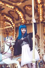Saya (rubenfcid) Tags: carousel horse funfair tiovivo bluehair girl woman lady femme model fun fashion glamour shooting modeling leatherjacket dress pinkdress parquedeatracciones carrusel gente