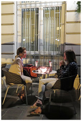 """Late-Night Drinks with a Friend"" - Lubljana, Slovenia (TravelsWithDan) Tags: women friends talking dessert drinks night candid streetphotography canon conversation lubljana slovenia urban downtown candlelight"