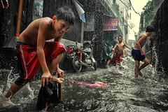 Manila, Philippines Who care if it flood? (Mio Cade) Tags: flood shower rain children kid boy manila tondo philippines social documetary swim play fun enjoy monsoon