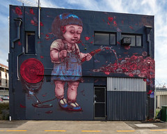 Poppy (Steve Taylor (Photography)) Tags: elliotfrancesstewart hose girl watering mollettstreet reel art mural graffiti streetart building office red pink blue mauve purple sad child newzealand nz southisland canterbury christchurch city cbd flower poppy water