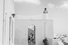 Contrast of a moment. (Jordi Corbilla Photography) Tags: nikon d750 streetphotography streetphoto street blackandwhite bw bride wedding jordicorbilla jordicorbillaphotography santorini fira greece