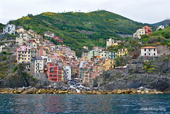 Riomaggiore, Cinque Terre, Italy (GSB Photography) Tags: italy riomaggiore 5villages italianriviera coastalvillage coast ocean sea harbor church unescoworldheritage fishing colorful architecture nikon d60 cinque terre cinqueterre mediterranean water rock shoreline hills terraces italian aplusphoto