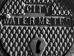 My neighborhood in Albuquerque with iPhone. (cbrozek21) Tags: blackandwhite pattern watermeterwater meter cover city