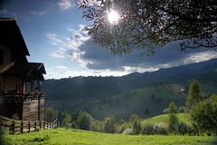 A bit of sunshine through the leaves (**Alice**) Tags: sony450 romania romnia 16105mm satpetera landscape hills deal cas house tree copac clouds nori sun soare sunshine greengrass iarbverde