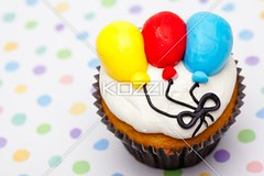close-up shot of a muffin with balloon design (farafood8877) Tags: birthday party food cake closeup balloons dessert creativity photography design yummy colorful pattern display anniversary decoration cream tasty nobody nopeople whippedcream sugar gourmet indoors polkadots celebrations cupcake sprinkles snack icing junkfood dots muffin multicolored foodanddrink displayed indulgence confectionery imitation tempting elegance prepared buttercream colorimage readytoeat sweetfood unhealthyeating desserttopping