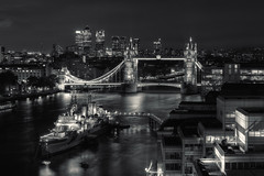HMS Belfast and Tower Bridge  Explore #58 (Subversive Photography) Tags: city longexposure blackandwhite bw london rooftop thames night towerbridge lights explore hmsbelfast urbanexploration canarywharf subversive riverthames hdr urbex danielbarter