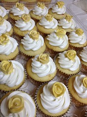 Gold rose cupcakes (Erika's Edible Art) Tags: birthday flowers roses white flower cakes cup leaves rose yellow cake cupcakes leaf ace royal cupcake icing frosting sculpted whipped fondant buttercream gumpaste aceofcakes mmfondant
