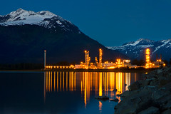 Golden Palace (Ania.Photography) Tags: blue usa mountain color reflection industry water horizontal alaska night port landscape photography golden evening energy factory power state unity tranquility bluesky snowcapped oil backgrounds valdez refinery controversy controversial mountainrange tranquilscene manufacturing chugachstatepark oilindustry oilterminal buildstructure alaskausastate