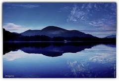Imagine (Nicolas Valentin) Tags: uk light sky mountain lake cold reflection nature water clouds landscape scotland fishing bravo scenery kayak alba loch wilderness lomond lochlomond ecosse kayakfishing nicolasvalentin kayakscotland