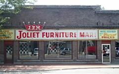 Joliet Furniture Mart, before (stoneofzanzibar) Tags: vintage neon faded storefronts joliet bulbsigns gratesigns jolietfurnituremart