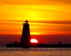 Ludington Lighthouse Sunset (Craig - S) Tags: sunset summer vacation people lighthouse mi fun evening pier dusk michigan lakemichigan mich tranquil ludington ludingtonmichigan northbreakwater sternsbeach