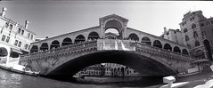 Rialto Bridge (pho-Tony) Tags: venice bw italy white 3 black film 35mm lens lomo lomography horizon 28mm it panoramic ishootfilm swing ilfordhp5 plus hp5 swinglens analogue 135 russian venezia perfekt ilford horizon202 202 industar veneto hp5plus russiancameras kompakt ilfosol filmisnotdead  horizon perfeckt ilfosol3 laserenessima  202
