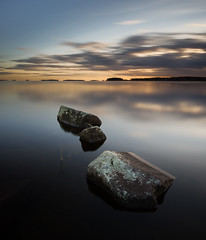 Triple (- David Olsson -) Tags: longexposure sunset lake 3 seascape nature water clouds landscape three nikon october rocks sundown sweden stones tripod karlstad le fx triple vnern 2012 linedup vrmland 1635 ndfilter d600 1635mm lakescape smoothwater skutberget smoothsky 2exposures manualblend manuallyblended davidolsson nd500 lightcraftworkshop 1635vr