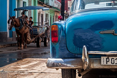 Horse Power of Another Kind (Mitch Ridder Photography) Tags: cuba cuban island islandofcuba caribbean caribbeanisland largestcaribbeanisland trinidad mountaintown color colorfulltrinidad trinidadstreet classiccar americanclassic americanclassiccar carriage horsedrawncarriage bluecar