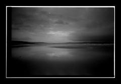 Reflection [Olympus OM10] EXPLORE (Mr B's Photography) Tags: clouds dark reflections beach water sky film 35mm kodak trix tetenal paranol olympusom10