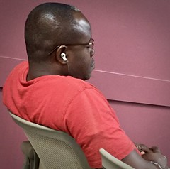 Waiting and listening or just asleep? (LarryJay99 ) Tags: men male man guy guys dude dudes earbuds smartphone cell blackman red redshirt handsome attractive facialhair profile