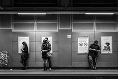 Tube Night Life (stefanopad82) Tags: london uk overground underground tube black white lifestyle people standing waiting nght life hug phone neon light platform poster shoreditch bin