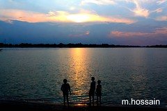 Childhood should be carefree, playing in the sun; (manwar2010) Tags: sunset people art nature water childhood canon river geotagged flickr you tag award contacts come geo geotag
