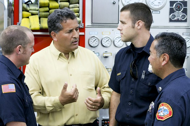 Juan speaking with some firefighters