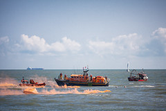 Rescue (Jeremy Vickers Photography) Tags: sea summer rescue orange boats smoke bluesky lifeboat raft southwold drowning rnli canonef135mmf2lusm canoneos40d