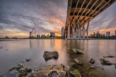 BlazingSheares [Explored] (Scintt) Tags: city travel bridge light sunset sky urban panorama costa sun tourism water wheel gardens by skyline architecture clouds marina buildings way evening bay hall flyer singapore rocks long exposure flickr slow place skyscrapers stitch structures dramatic surreal ferris images east explore shutter getty sands exploration foreground raffles bahru shenton kallang tanjong rhu sheares scintillation explored scintt gettysingapore