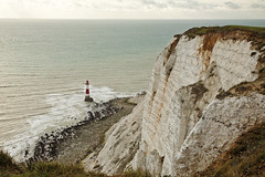 Beachy Head Lighthouse, Eastbourne, United Kingdom (Walter-Ego) Tags: ocean travel sea england cliff lighthouse white tourism beach grass danger warning chalk sand rocks europe day unitedkingdom hiking walk south suicide lifestyle tourist calm erosion eastbourne destination beacon whitecliffs eastsussex gravel beachyhead holidaydestination
