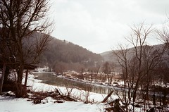 Natural Beauty (Justin Wolfe) Tags: road street wood old trip travel trees winter white snow mountains cold film ice nature wet water beautiful analog rural forest 35mm vintage fence landscape frozen woods stream soft vermont alone little snowy north grain rangefinder powder minimal hills faded freeze fujifilm lonely winding hillside killington snowfall simple treeline tones northeast vt konicac35 curving justinwolfe jwolfe