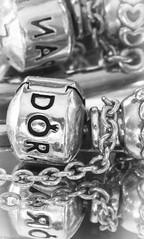 pandora reflections (Wayne Stiller) Tags: chaincharm inthemirror jewelery luckycharm macromondays macrotextures pandora
