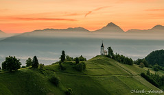 Church on the hill (Marielle - Fotografie) Tags: slovenia church sunrise mountains mountain green nature hills nikon d5100 vacation jamnik summer sky fog