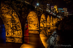 Stone Arch Bridge (Minneapolis, MN) (ECS Photography) Tags: city bridge blue light red water minnesota yellow stone river landscape long exposure arch minneapolis hdr