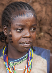 Girl From Menit Tribe With Facial Tattoos, Jemu, Omo Valley, Ethiopia (Eric Lafforgue) Tags: africa portrait people haircut color girl childhood smiling vertical tattoo youth outside photography necklace kid colorful day child outdoor young culture thoughtful shy jewelry tribal ornament innocence omovalley tradition ethiopia tribe ethnic hairstyle scar wondering scarification bodymodification oneperson jewel lookingaway onepeople hornofafrica ethnology omo eastafrica onepersononly realpeople colorimage beautify waistup headandshoulder oneteenagegirlonly africanethnicity menit onechildonly bodytransformation jemu ethiopianethnicity oneteenager onekidonly onelittlegirlonly eth6133