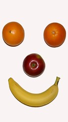 the title (RiseUpLabsLtd.) Tags: red food orange abstract green apple smile yellow fruit happy juicy healthy tag1 pyramid skin juice background unitedstatesofamerica banana fresh whole eat health vegetarian citrus ate variety diet assortment wholesome nutrition nutritious potassium vitamin