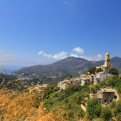 Picturesque Legnaro high on a hill above the Ligurian Sea (Bn) Tags: ocean blue trees houses sea summer vacation sky italy holiday tree green church saint rural walking landscape topf50 mediterranean riviera italia village view wine hiking liguria olive culture medieval peter trail vineyards serenity sweat di vegetation terre vista civilization hiker gras viewpoint picturesque cinque adriatic vino italianriviera orchards quietness 200m agriturismo wijn levante cliffside ligurian hightrail caruggi 50faves abovesealevel legnaro