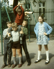 Give you three guesses to who's in charge (theirhistory) Tags: boy girl playground socks shirt shoes child dress swing jumper shorts railings