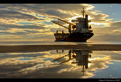 Ship run aground reflected (kel0) Tags: sky beach valencia clouds port barco ship vessel playa reflected cielo nubes aground buque elsaler reflejado encallado