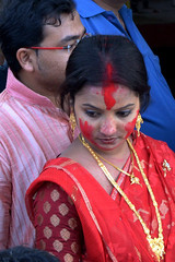 A Bengali couple (after vermilion game ) watching immersion of Durgapratima of Sovabazar Rajbari,Bagbazar Ghat, North Kolkata, India. (biswarupsarkar72) Tags: festival durga north festival sovabazar durga bisarjon ghat bengal kolkata puja subho bijaya bagbazar sovabazar rajbari