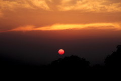 Solitary Sunset (sir_watkyn) Tags: sunset sun india west clouds canon landscape eos rebel interestingness silhouettes hues dslr bengal t3i 600d abigfave anawesomeshot flickrdiamond chakdighi sirwatkyn