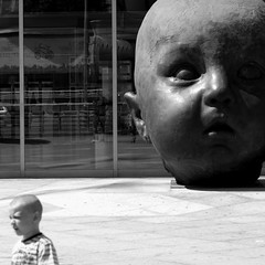 Face off (gregjack!) Tags: madrid street light boy sculpture reflection face spain head streetphotography espana installation atocha bwblackandwhite atochastation
