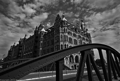 Speicherstadt / Hamburg / Germany (zilverbat.) Tags: city travel blackandwhite bw history architecture clouds buildings germany lights blackwhite wasser cityscape zwartwit bokeh centre curves hamburg bridges dramatic wolken wideangle unesco le dslr hafen alster altstadt canondslr centrum speicherstadt warehouses hotspot architectuur duitsland worldheritage lightroom reizen binnenalster krupp brucke duits authentiek bruggen dokken lenight zollkanal unescoheritage groothoek pakhuizen hanzestad blackwhitephotos zwartwitfotografie canon7d zilverbat hanzestadt