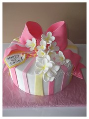 pink and yellow (The Whole Cake and Caboodle ( lisa )) Tags: pink flowers flower yellow plumeria bow frangipani present parcel whangarei birthdaycakes fondant frangipanis birthdaycakeswhangarei